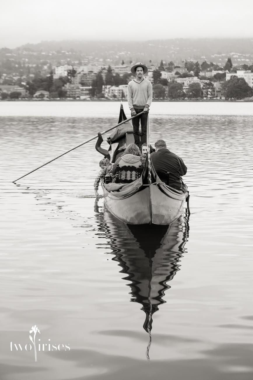 gondola with gondolier on Lake Merit in black and white