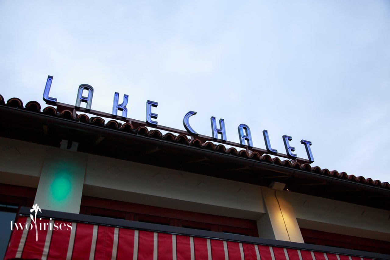 lake chalet sign in lights at dusk