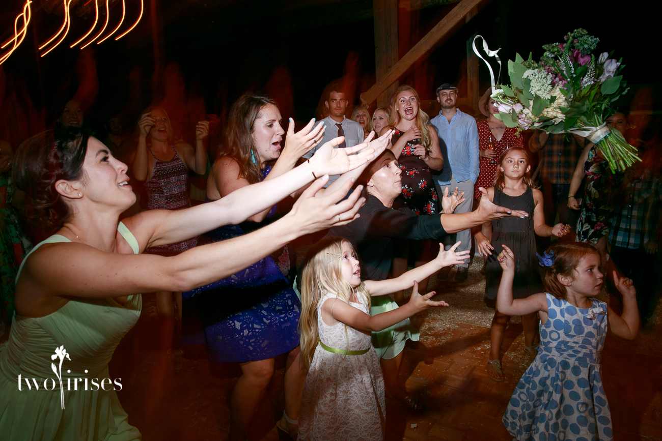 Cow Track Ranch barn wedding bouquet toss